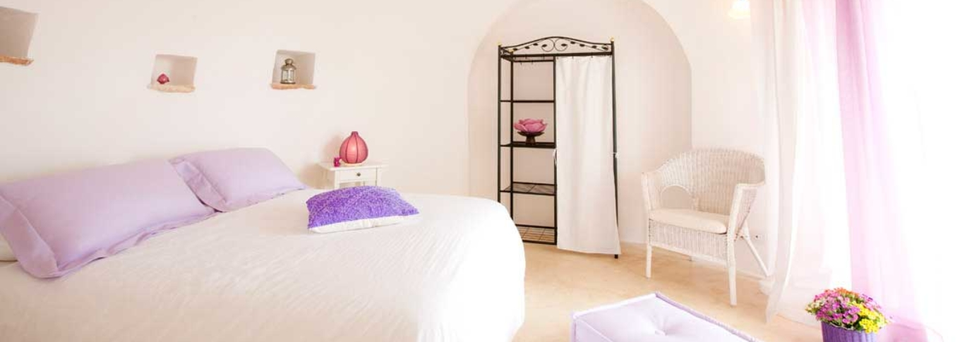 Interior view of the bedroom at Rosa dei 4 Venti in Puglia, Italy