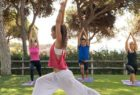 group yoga class in the garden at Pine Cliffs