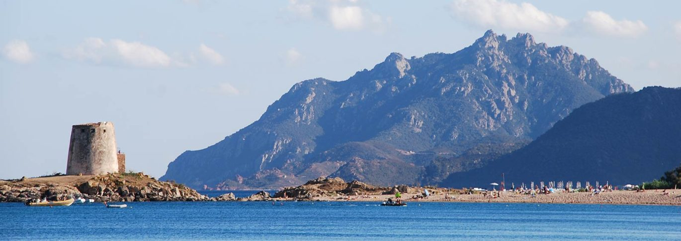 Seaview with tower and mountains from Galanias, Sardinia