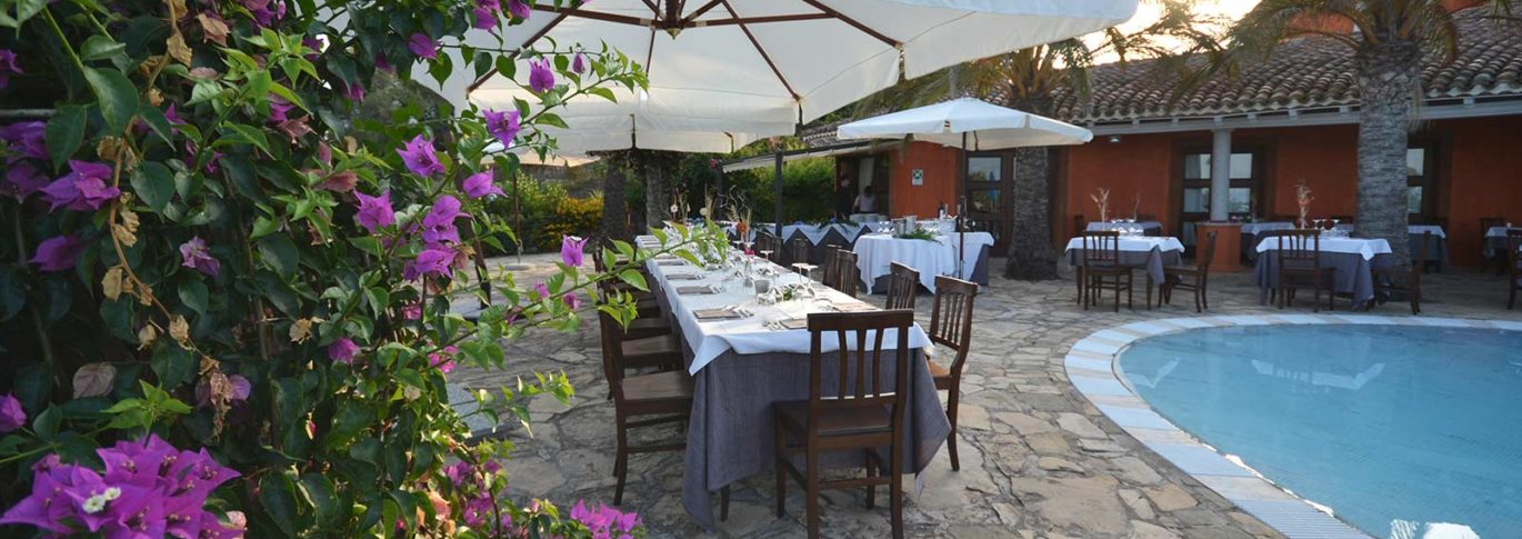 Poolside dining at Galanias, Sardinia