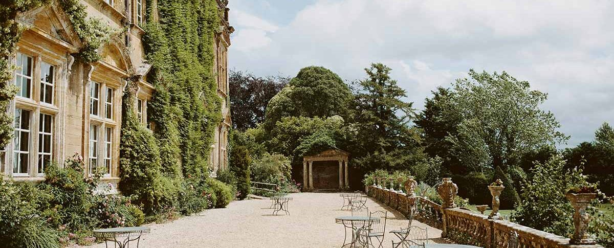 Brympton House terrace with chairs and tables